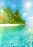 Tropical island beach with perfect sky. Retro style. Toned picture with light leaks and lens flares Royalty Free Stock Image