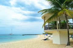 Tropical island beach scene. Relaxing Caribbean summer vacation. royalty free stock images