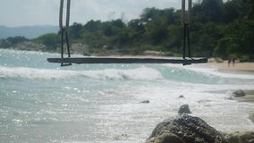 Tropical Island Beach and Swing. Splashing waves in the Sea in slow motion. Paradise at Koh Samui. 1920x1080. Hd stock video footage