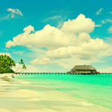 Tropical island beach with turqiuse water and blue sky. Landscape of tropical island beach with turqiuse water and blue sky. retro style toned photo Royalty Free Stock Photography