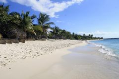 Tropical island beach with white sand royalty free stock photo