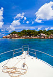 Tropical island and boat Stock Images