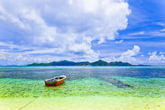 Tropical island and boat Stock Photography