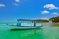Tropical island and boat Royalty Free Stock Images