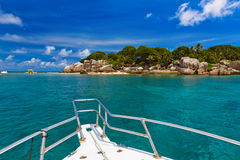 Tropical island and boat on Seychelles Royalty Free Stock Image