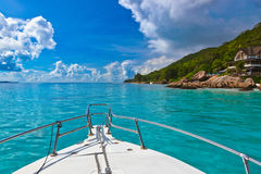 Tropical island and boat on Seychelles Stock Photo