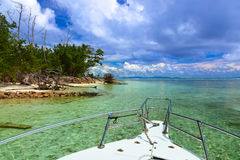 Tropical island and boat on Seychelles Stock Image