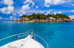 Tropical island and boat Stock Image