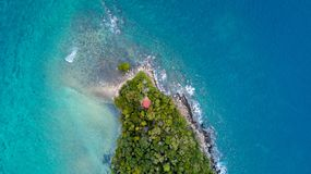 Tropical Island cliff from aerial view in Manukan island malaysia stock photography