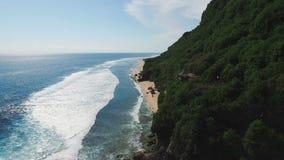 Tropical island coastline aerial scene. Aerial video footage bali ocean coastline with empty beach stock footage
