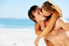Tropical island couple kiss Stock Photo