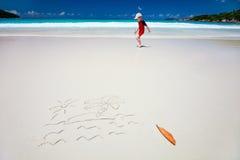 Tropical island drawing on sand Stock Image