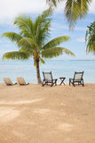 Tropical island with empty chairs Stock Photos