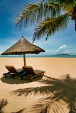Two lonely loungers on the deserted beach of Hainan Island. The tropical island of Hainan is located in the south of China, on the same latitude as Hawaii stock photo