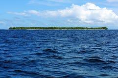 Tropical Island on the horizon Royalty Free Stock Photography