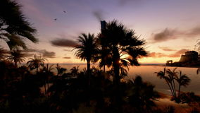 Tropical Island, Hotel on Coastline and yachts at sunset, panning, stock footage stock video