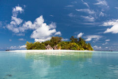 Tropical island with huts Royalty Free Stock Photos
