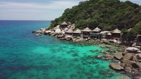 Tropical Island Koh Tao with Turquoise Water Bay and Residental Area on Shore in Thailand. Aerial Top View. Shot with a DJI Mavic fps 29,97 4k stock video footage