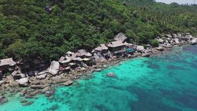 Tropical Island Koh Tao with Turquoise Water Bay and Residental Area on Shore in Thailand. Aerial Top View. Shot with a DJI Mavic fps 29,97 4k stock video