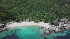 Tropical Island Koh Tao with Turquoise Water Bay and Residental Area on Shore in Thailand. Aerial Top View. Shot with a DJI Mavic fps 29,97 4k stock footage