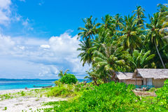Tropical island landscape with huts Royalty Free Stock Photography
