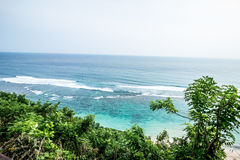 Tropical island landscape, ocean on a bacakground. Beautiful view from the cliff to the coast. Outdoor scenery, Bali Stock Photo