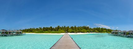 Tropical island landscape panorama with beautiful vibrant ocean and sky Stock Photo