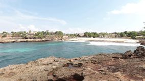 Tropical island Nusa Lembongan in Indonesia. Sunny day, blue ocean, waves, rocks. stock video footage