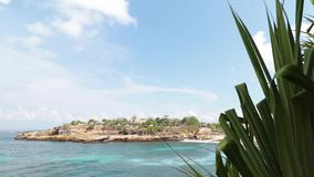 Tropical island Nusa Lembongan in Indonesia. Sunny day, blue ocean, waves, rocks. stock video