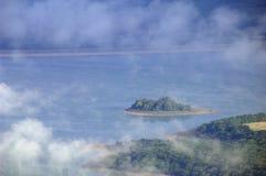 Tropical island at ocean Royalty Free Stock Photos