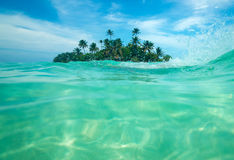 Tropical island in the ocean Royalty Free Stock Images