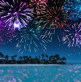 The tropical island with palm trees at the ocean. Festive New Year's fireworks over the tropical island Stock Photography