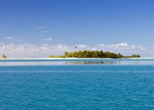 The tropical island with palm trees in the sea.  Royalty Free Stock Photos