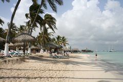 Tropical Island Palms. Palms and cabanas at the beach, Caribbean Island, Aruba Stock Images