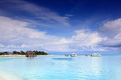 Tropical island paradise. Beautiful holiday resort in Kandooma overlooking the sea with bright shining sky Stock Images