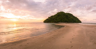 Tropical island and paradise beach at sunset Stock Image