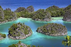 Tropical island paradise Raja Ampat Royalty Free Stock Images