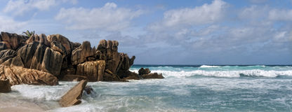 Tropical island. Picturesque boulders on the edge of Grand Anse beach, La digue island , Seychelles, Africa Stock Photos