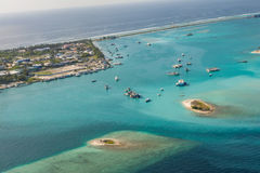 Tropical island port arial view with boats and ships at Maldives Stock Image