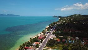 Tropical Island with Roads and Accomodation. Aerial View. With a DJI Mavic fps29,97 4k stock video footage