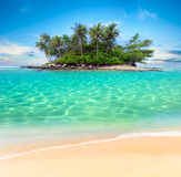 Tropical island and sand beach exotic travel background. Landscape Stock Photography