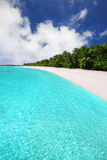 Tropical island with sandy beach with palm trees and tourquise c. View to Tropical island with sandy beach with palm trees and tourquise clear water Stock Images