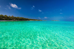 Tropical island with sandy beach and pristine water Stock Image