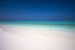 Tropical island with sandy beach and pure clear lagoon Royalty Free Stock Photos