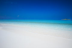Tropical island with sandy beach with turquoise clear water in Maldives Island Royalty Free Stock Image