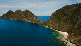 Tropical island and sandy beaches, aerial view. El Nido. Tropical islands, aerial view. Aerial view: sea and the tropical island. Tropical bay in El Nido stock video footage