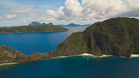 Tropical island and sandy beaches, aerial view. El Nido. Tropical islands, aerial view. Aerial view: sea and the tropical island. Tropical bay in El Nido stock footage