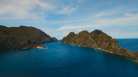 Tropical island and sandy beaches, aerial view. El Nido. Tropical islands, aerial view. Aerial view: sea and the tropical islands. Tropical bay in El Nido stock footage