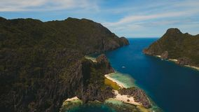 Tropical island and sandy beaches, aerial view. El Nido. Tropical islands, aerial view. Aerial view: sea and the tropical island. Tropical bay in El Nido stock video