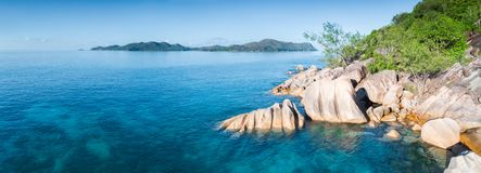 Tropical island with sea and palm taken from drone. Seychelles aerial panorama photo royalty free stock image